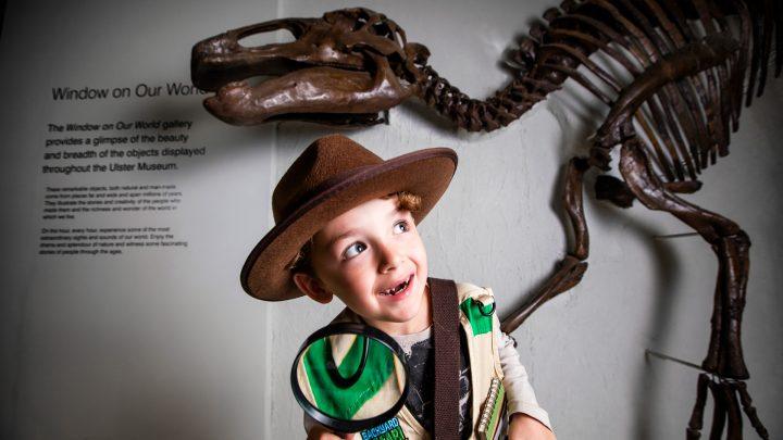 Boy Examining a Dinosaur Skeleton at Ulster Museum