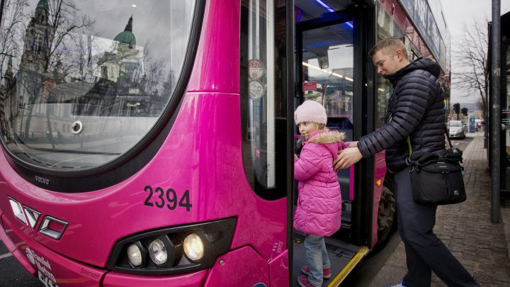Family travelling on Translink Metro Bus