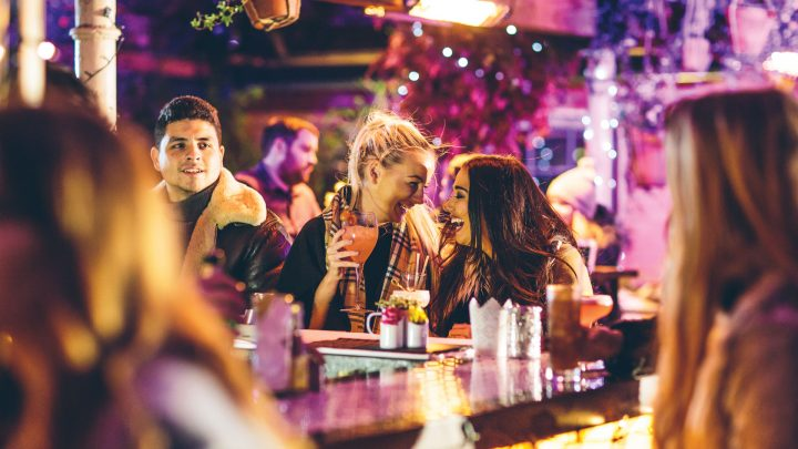 Friends Enjoying a Cocktail at The Perch Rooftop Bar
